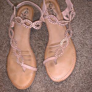 Light pink sandals with rhinestones.